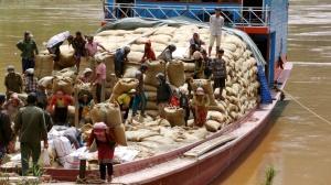 Boat Unloading Grain Headed For China