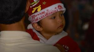 Child at Carnival on December 24th - Tay Nihn, Vietnam