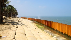 Sandbags and a Retaining Wall are Fixtures of parts of Cui Dai Beach - Hoi An, Vietnam